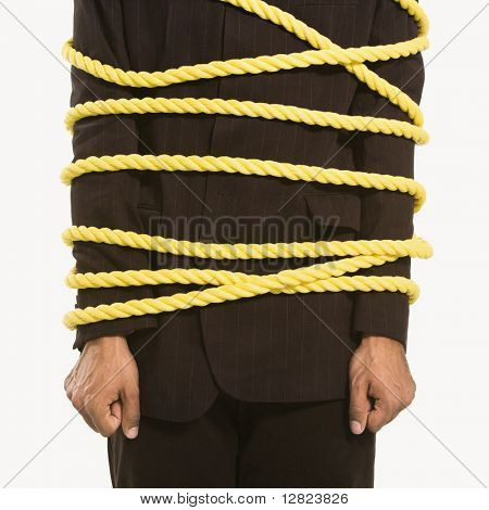 African American businessman wrapped in yellow rope.