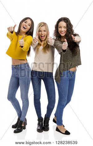 Group of teenage friends with thumbs up