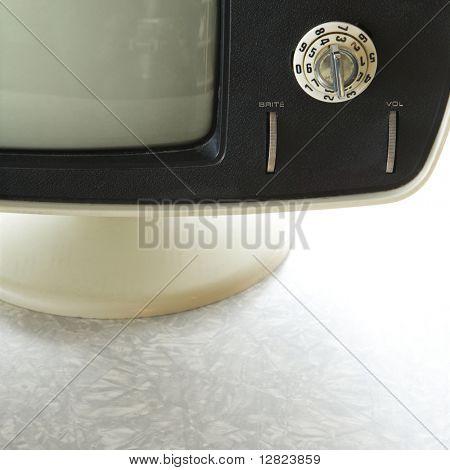 Close-up still life of vintage television set with adjustment knob.