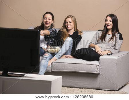 Girls watching movies with popcorn