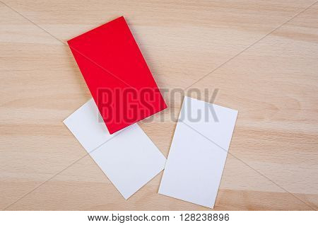 Small pieces of white paper and cardboard