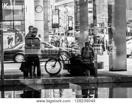 NEW YORK-MARCH 31-A busy New York City street scene through the glass and reflections along Park Avenue on March 31 2016 in New York City.