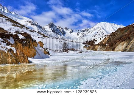 Trail On Frozen River In Mountains Of Eastern Sayan