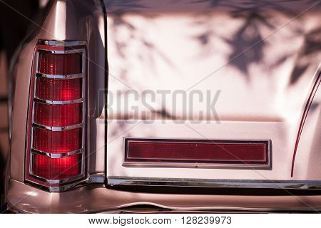 Detail on the rear light of a vintage car.