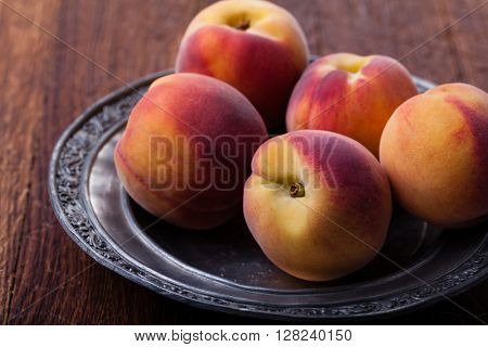 peach on an iron plate