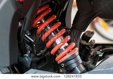 Motorcycle shock absorber a device for absorbing jolts and vibrations especially on a motor vehicle.