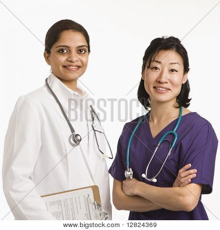 Indian and Asian mid adult woman doctors portrait on white background.