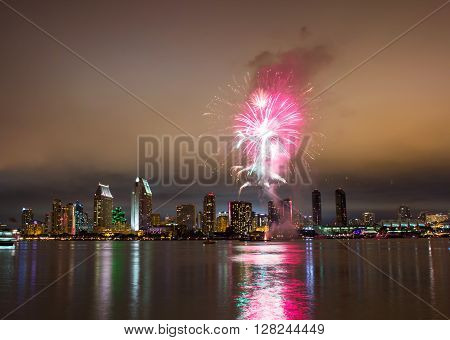 San Diego 4th of July fireworks over skyline. Long exposure night capture.