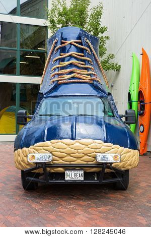 FREEPORT, MAINE, USA-AUG 31st, 2014: L.L. Bean was founded in 1912 by Leon Leonwood Bean. A replica of its famous boot has been converted to a promotional vehicle and stands outside the flagship store.
