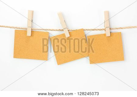 Notice card brown paper and wood clips on white background
