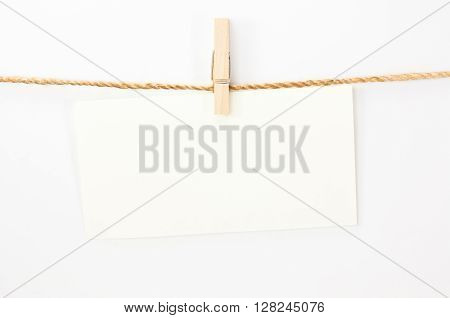 Notice card white paper and wood clip on white background