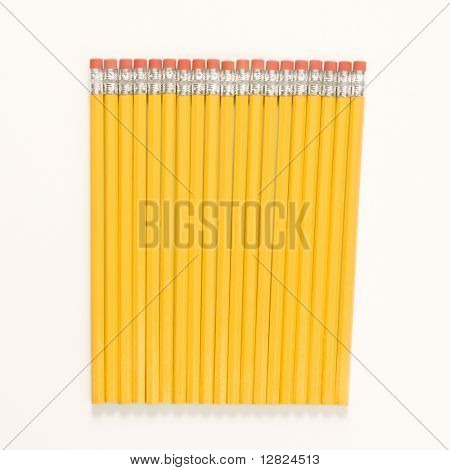 Group of new unsharpened pencils lined up in an even row.