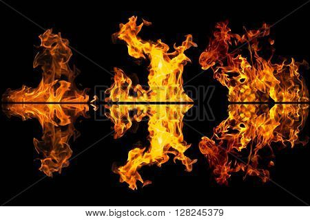 Fire flames texture reflected on black background
