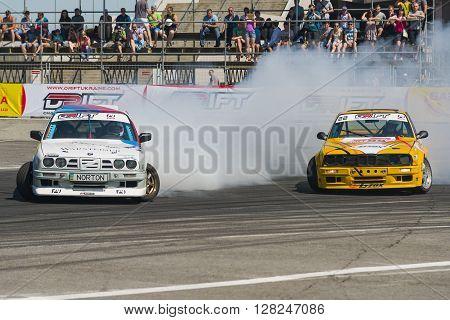 Lviv Ukraine - Juny 7 2015: Rider Ruslan Yezerov and Volodymyr Palariev on the car brand BMW overcomes the track in the championship of Ukraine drifting in Lviv.
