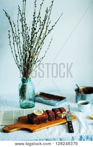Cupcake for breakfast . Rustic dark styling. With retro filter effect. Homemade fresh-baked milk cake on the white tablecloth at a window. Country white kitchen ** Note: Soft Focus at 100%, best at smaller sizes
