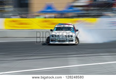 Lviv Ukraine - Juny 6 2015: Rider Yezerov Ruslan on the car brand BMW overcomes the track in the championship of Ukraine drifting in Lviv.