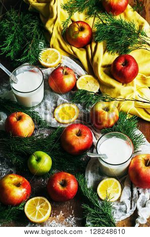 Apples on a dark wood background. Toning. Sweet apples on wooden background. Ripe red apples on the table. Top view. Flat lay. Rustic dark food style. Red apples on wooden table
