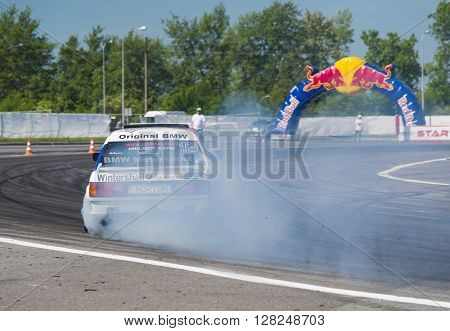 Lviv Ukraine - Juny 6 2015: Unknown rider on the car brand BMW overcomes the track in the championship of Ukraine drifting in Lviv.