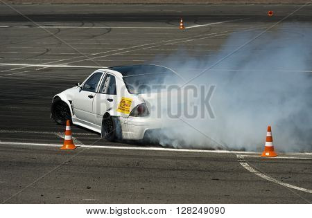 Lviv Ukraine - June 6 2015: Unknown rider on the car brand Nissan overcomes the track in the championship of Ukraine drifting in Lviv.