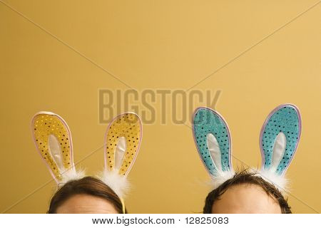 Caucasian mid adult couple wearing rabbit ears.