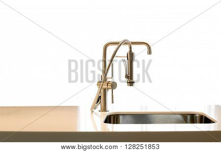 Metal modern design faucet in a kitchen isolated in white background