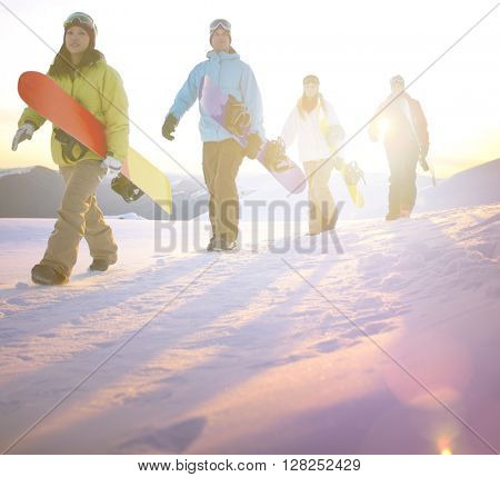 People on their way to snow boarding.