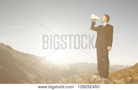 Businessman Shouting Top Mountain Concept