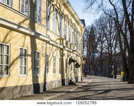 TURKU, FINLAND - APRIL 30: Springtime in Turku with leafless trees and architecture