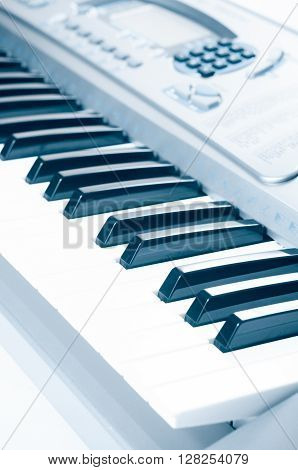 Key electronic piano closeup. close frontal view. ** Note: Visible grain at 100%, best at smaller sizes