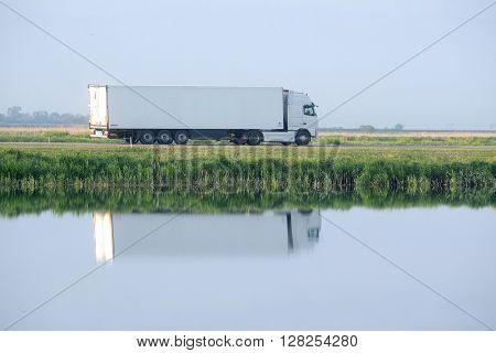 Russia, Krasnodar Region - April, 30, 2016: Cargo transport on the highway in Krasnodar Region, Russia