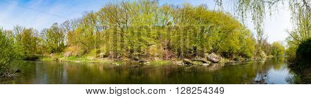Panorama of small river in forest
