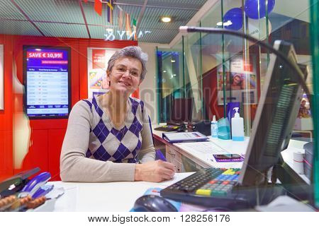 FRANKFURT, GERMANY - APRIL 07, 2016: Travelex worker at Frankfurt Airport. Travelex Group is a foreign exchange company founded by Lloyd Dorfman and headquartered in London.