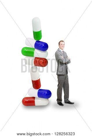 Pills in a stack with businessman