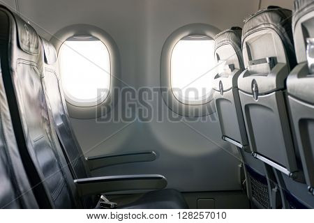 FRANKFURT, GERMANY - APRIL 07, 2016: inside of Lufthansa A320 economy class.  Deutsche Lufthansa AG, commonly known as Lufthansa is a major German airline.