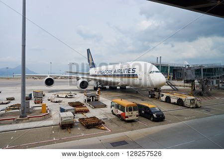 HONG KONG - APRIL 09, 2016: Airbus A380 of Singapore Airlines docked in Hong Kong Airport. Singapore Airlines Limited is the flag carrier of Singapore with its hub at Singapore Changi Airport.