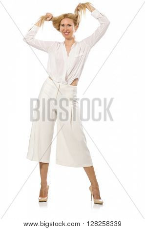Blond hair model in elegant flared pants isolated on white