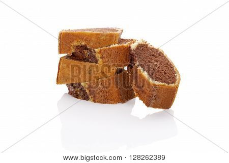 Delicious bundt cake on white background with reflection. Traditional european sweet bundt cake.