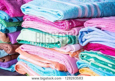 Multicolored fabric in outdoor market colorful mixture of towel red blue aqua blue black yellow orange pink fuchsia golden green gray silver Magic fabric theme
