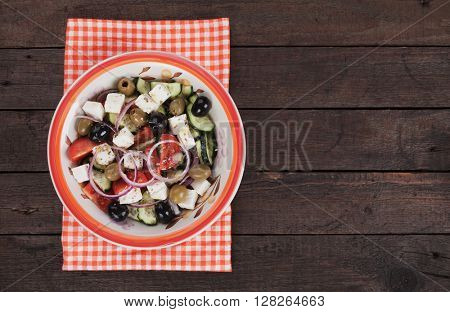 Greek salad with feta cheese, tomato, cucumber, onion and olives