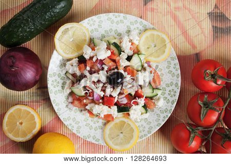Shopska salad with cheese, tomato, cucumber, red pepper, onion and olive
