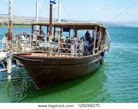 TIBERIAS ISRAEL - OCTOBER 20: Excursion wooden boat near the pier on the Sea of Galilee in Tiberias Israel on October 20 2015