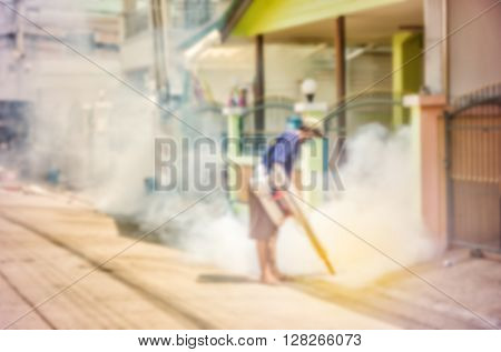 Blurred focus officer is spraying chemical for anti an outbreak of dengue fever