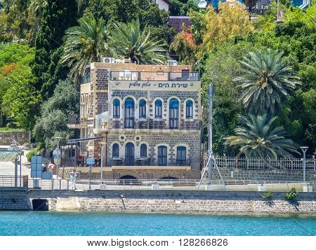 TIBERIAS ISRAEL - OCTOBER 20: View of the city on the hill from the Sea of Galilee in Tiberias Israel on October 20 2015
