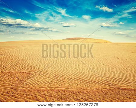 Vintage retro effect filtered hipster style image of white sand dunes on sunrise, Mui Ne, Vietnam