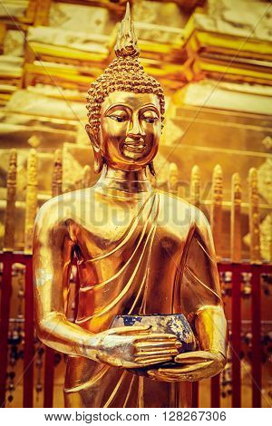 Vintage retro effect filtered hipster style image of gold Buddha statue in Wat Phra That Doi Suthep, Chiang Mai, Thailand