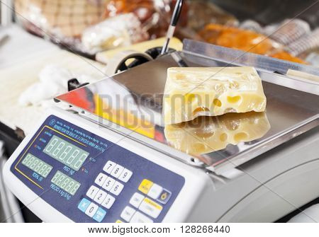 Packed Cheese On Weight Scale In Store