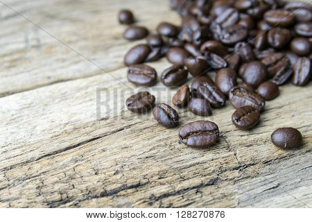 Coffee beans on wood background, grind, black, brown
