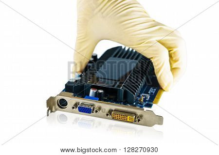 Video card closeup at port connector with Man's hand on white background