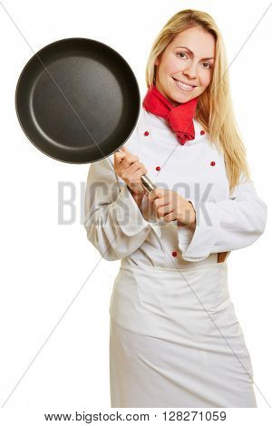 Smiling woman as cook in apprenticeship holding a frying pan