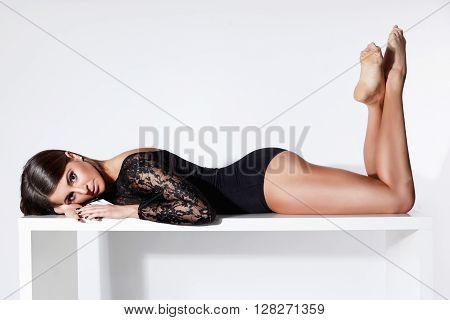 Young prettywoman laying in sexy lacy bodysuit